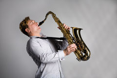 Musician plays the saxophone. Stock Photography