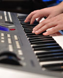 Musician plays a synthesizer Royalty Free Stock Images