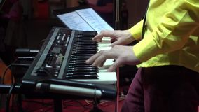 Musician plays a synthesizer stock footage