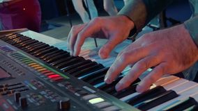 Musician plays a synthesizer. Concert performance stock footage