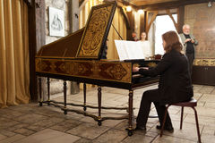 Musician Plays The Harpsichord Stock Photos