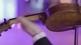 Musician plays the violin, a classical musical instrument stock footage