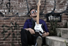 Musician posing with his guitar Stock Image