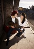 Musician and Pretty Girlfriend Downtown Stock Photos
