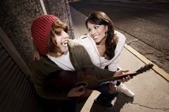 Musician and Pretty Girlfriend Downtown Royalty Free Stock Photo