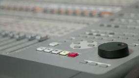 Musician pushes stop button on the mixing panel stock footage