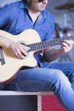 Musician rehearsing with guitar Stock Photos