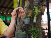 A musician`s hand playing Salor, two or three-string spike fiddle used in the Lanna region or in the North of Thailand. A musician`s hand playing Salor, two or royalty free stock images