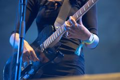 Musician`s hands playing electric guitar. Closeup of musician`s hands playing electric guitar Royalty Free Stock Photography