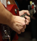 Musician's hands. A musician playing guitar, fragment - hands Royalty Free Stock Photo