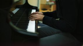 Musician's Hands Playing Piano in a Studio stock video footage
