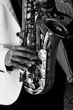 Musician`s hands during playing saxophone. stock photo
