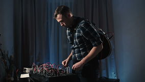 The musician's home studio experimenting with synthesizers. stock footage