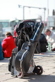 Musician's luggage. The luggage of a musician located on a street in Venice near the sea in a sunny day Stock Images