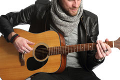 Musician sitting down with guitar Stock Image