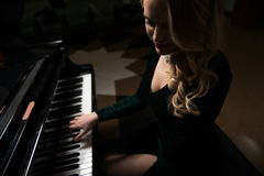 Musician Sitting and Playing Piano Royalty Free Stock Image