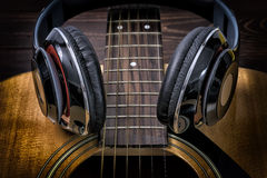 Musician Songwriter. Headphone and Guitar royalty free stock image