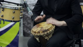 Musician on stage playing the African drum. Close-up stock video footage