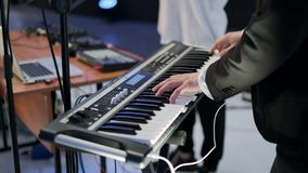 Musician tunes electronic musical instrument stock video