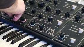 Musician tunes electronic musical instrument stock footage