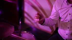 Musician turns the drummer drumstick in his hand stock video