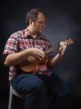 Musician with ukulele Royalty Free Stock Photos