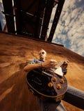 Musician under bridge Stock Photography
