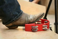 Musician are using a foot knocked tambourine Royalty Free Stock Photo
