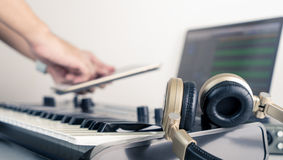 Musician using table to control Music studio working application Royalty Free Stock Images