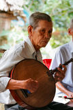 Musician from Vietnam. Old musician from Vietnam. He was living in a small village along Mekong Delta stock photos