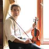 Musician and the violin Stock Photo