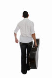 Musician walking away Royalty Free Stock Photos