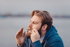 The musician who plays ethnic instruments. bearded man playing the jew`s harp. The musician who plays ethnic instruments. bearded man playing the jew`s harp Stock Image