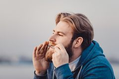 The musician who plays ethnic instruments. bearded man playing the jew`s harp. The musician who plays ethnic instruments. bearded man playing the jew`s harp Stock Photo