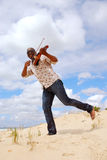 Musician With Violin Playing On The Beach Royalty Free Stock Image