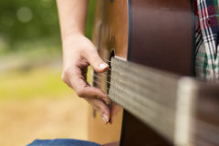Musician woman and her guitar Stock Images