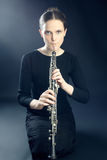 Musician woman playing oboe musical instrument. Young musician woman playing oboe. Oboist musical instrument play. It's not clarinet, it's oboe! It is first Royalty Free Stock Photography