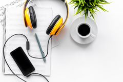 Musician work set with blank paper for notes, mobile and headphones on white background top view space for text Royalty Free Stock Photos