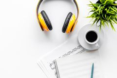 Musician work set with paper with notes and headphones white table background top view space for text Stock Image