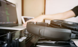 Musician is working on music work station. Musician is working on home music work station Royalty Free Stock Image