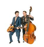 Musicians. Two musicians with guitar and double bass isolated on white background royalty free stock photography