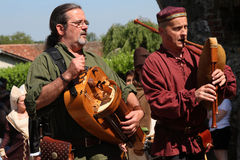 Musicians with ancient instruments Royalty Free Stock Photo