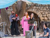 Musicians in authentic costumes play bagpipes and pipes for visitors at the annual festival `Jerusalem Knights`. Jerusalem, Israel, September 29, 2018 royalty free stock images