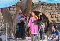 Musicians in authentic costumes play bagpipes and pipes for visitors at the annual festival `Jerusalem Knights`. Jerusalem, Israel, September 29, 2018 stock photos