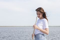 Musicians or beautiful women outdoor. Nature, meditation. Listen to your heart. A flute, unity with nature. Musicians or beautiful woman outdoor. Nature royalty free stock photos