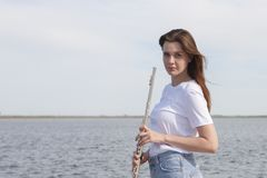 Musicians or beautiful women outdoor. Nature, meditation. Listen to your heart. A flute, unity with nature. Musicians or beautiful woman outdoor. Nature stock photography