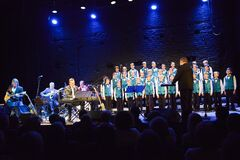 Musicians and boys choir onstage