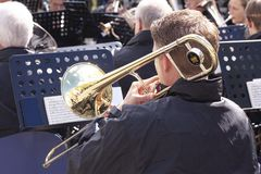 Musicians from a brass band playing outside in a town market square. Copenhagen, Denmark - May 4, 2019 stock photography