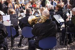 Musicians from a brass band playing outside in a town market square. Copenhagen, Denmark - May 4, 2019 stock image