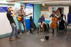 Musicians busking in the Paris Metro. Paris, France-May 16, 2013. Group of musicians busking in a Paris Metro train station stock images